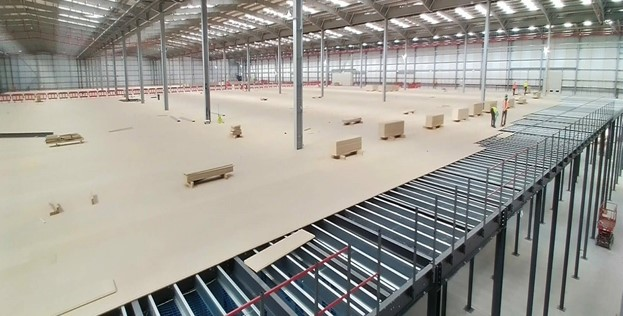 Hi-Level Mezzanine Installs Floor For Robot Use for International Retail Company